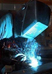 David Ross, shop manager for Earthworks Environmental, welds a cross bracket.
