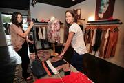 Penelope T Boutique sales associate Danielle Frouws, left, and store manager Taryn Williams at the Tampa clothing and accessories store.