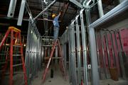 Rich Henson of J.A. Green Plumbing welds during construction at a former Borders bookstore in Tampa, soon to be a Florida Orthopaedic Institute clinic.