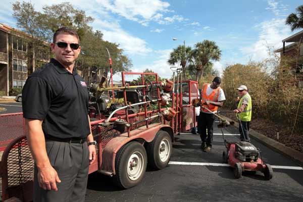 Joe Chiellini, president and CEO of Ameriscape Services with a crew working at South Pointe Apartment Homes in South Tampa.
