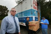 Atlantic Relocation Systems' Bob Glenn, VP and general manager, with movers Al Muguercia and Frank Muguercia.