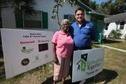 Jose Garcia, executive directive of Rebuilding Together Tampa Bay, with homeowner Annie Seay, who had her home remodeled in St. Petersburg.