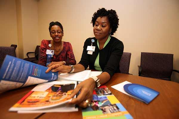 Erika Harris, external relations liaison at H. Lee Moffitt Cancer Center & Research Institute, and Cathy Grant, director of diversity, during a meeting.