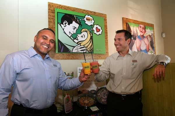 At Evos in St. Petersburg, Michael Jeffers and Alkis Crassas, co-founders, toast with smoothies.