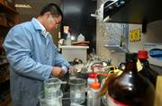 """TempTroll's Haitao """"Eddie"""" Li, Material Scientist, tests chemical recipes used in self-heating food heaters and wash cloths, at USF Department of Chemical Engineering."""