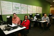 TruGreen's Jeff Walter speaks to outbound sales training class attendees, Jim Leuze, Denise Jones, and Robert Shepard.