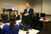 TruGreen's Jeff Walter speaks to outbound sales training class attendee, Dynisha Namauleg.