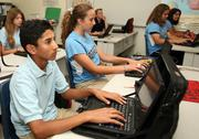 Roshan Kedar, Madeline Katsarelis and Jacy Kent work in class using Lenovo devices.