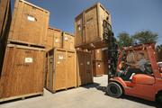 Brian White, warehouseman for Werner-Donaldson, preps storage containers for delivering household goods out of storage.