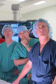 """Dr. Joshua Rovin, cardiovascular and thoracic surgeon; Dr. John Ofenloch, cardiovascular and thoracic surgeon; and Dr. Douglas Spriggs, interventional cardiologist, listen during a """"mock surgery"""" to review all steps of the procedure before performing the Tampa Bay area's first transcatheter aortic valve replacement (TAVR) at Morton Plant Hospital."""
