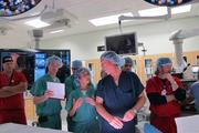 Morton Plant's TAVR team discusses steps of the procedure. (Left to right) Henry Woestmann, cath lab tech; Joshua Rovin, MD, cardiovascular and thoracic surgeon; John Ofenloch, MD, cardiovascular and thoracic surgeon; Lang Lin, MD, interventional cardiologist; Douglas Spriggs, MD, interventional cardiologist; Todd Kovach, MD non-invasive cardiologist and Bill Frederick, cath lab tech.