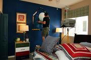 Jeff Monsein, owner of Splat Paint, painting a mural in one of the bedrooms at the Parade of Homes.