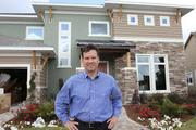 Mark Thomas, president of the Tampa Division of David Weekly Homes with the showcase model home.