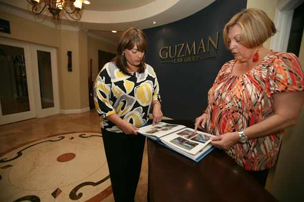 Jennifer Granell Alonso, law office administrator and event coordinator for The Event Center at Guzman Law Group PA, speaks with Janet Granell, client relations liaison and event coordinator, about an upcoming event.