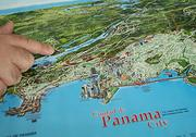 Carlos Lemos, president and CEO of Ambient Technologies Inc., with a map of the Panama Canal where his company will be drilling along the third set of locks.