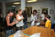 People sign up for the free pet food program and to adopt an animal at the Humane Society of Tampa Bay.