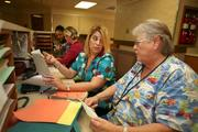 Lisa McCarthy and Carla Manson working at the nurses station at Mental Health Care Inc.