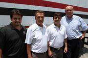 American Food Distributors Owner Bill Loiacano (second from right) with sons Joe (left) and Dean, and Brett Frank, company president.