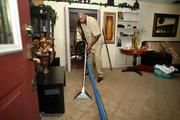 Jerald Mangum, floor technician for Immaculate Janitorial Services, cleaning carpet in a home.