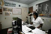 Lashunda Mangum, owner and president of Immaculate Janitorial Services, in her home office.