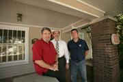 Phil Graham, Jr., senior principle, Hunter Booth, principal in charge, and Philip Graham IV, principle in charge in their in their office converted from a home.