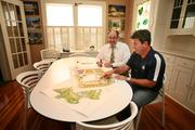 Phil Graham, Jr., senior principle, Hunter Booth, principal in charge, in their in their office converted from a home.