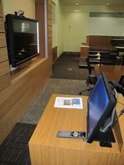 Inside a classroom/community meeting space at the Donald R. Tapia School of Business at St. Leo University.