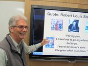 Stan McGahey, associate professor of international hospitality and tourism management at the Donald R. Tapia School of Business at St. Leo University teaches a class using Smart Board technology.