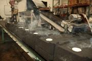 At Creative Sign Designs, a 1,600-degree furnace melts aluminum rims to be used in the making of sand cast aluminum parts.