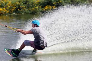At McCormick's, Jeff Mathis edges out on the course, creating a fantail of spray.
