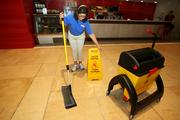 Janitorial specialist Monica Apestego, at work at the Sykes building in downtown Tampa during a nightime cleaning.