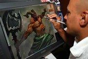"Artix Entertainment's lead artist for Adventure Quest Worlds, Alfonso ""Fonz"" Eljalek, works on a 3-D project."