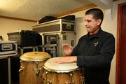 Coda Sound's Alex Cora, co-owner, producer/master engineer, plays the congas in the office every day.