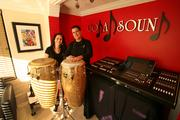 Coda Sound's Alex Cora, co-owner, producer/master engineer, and Maritza Astorquiza, co-owner and managing partner with congas that Alex plays every day at the office.