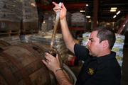 Joey Redner, CEO, pulls a sample of barrel-aged stout.