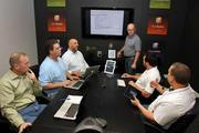 Product road map review meeting in the war room at Clare Controls with Michael Shaw, Doug Budinsky, Steven Brous, Brett Price, Andrew Patton and Ken French.