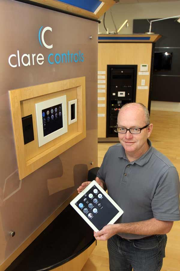 Brett Price, president of Clare Controls, using the ClareHome product that provides total home automation control system capabilities.