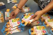 Cool Juice head quarters. Kimberly Walker, manager of sales planning and administration, sorts coupons for national distribution.