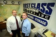 Chris Hunt, CEO and general counsel for First Class Moving Systems Inc., and Will Fallon, president and COO, in the office.