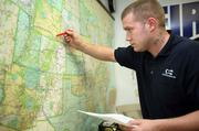 Jason Jones, quality control manager, checks a drivers route to the West.