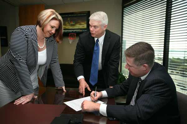 Jennifer Tanck, president and chief legal officer of Independent Financial Partners, with William Hamm, chief executive officer, and Barry Toole, chief compliance officer.