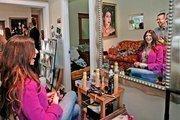 Darren Pena, hair stylist, works on Brandi Kamenar's hair.