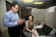 Intelladon CEO Marc Blumenthal speaks with Lorraine Harbert, customer relationship manager.