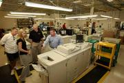 Our Town America. Regional developer tour of printing area and training session. Bassam Safi, North Carolina franchisee, Becky Neal, franchisee, Larry Neal, regional developer and franchisee, and Michael Plummer Jr., president.