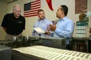 Our Town America. Regional developer tour of printing area and training session.  Larry Neal, regional developer and franchisee, Michael Plummer Jr., president, and Robert Ortiz, production manager, review product during a press run.