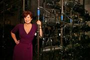 Tampa Bay Parenting Founder and Editorial Director Angela Ardolino has partnered with the Straz Center to diversify offerings and reach the proper audience.  She poses with stage lighting units used in theater productions.