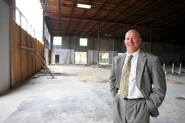 PrimeGroup Insurance Services President Ed Ellsasser standing in currently unfinished space in the Center.