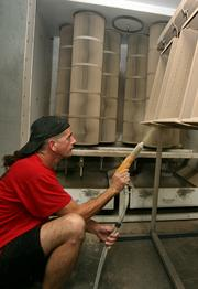 Robert Miller, powder coater, painting drawers at Refurbished Office Furniture Inc.