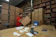 Anthony Cruz, shipping, boxing a shipment.