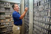 Marshall Stevens in data/tape storage area.